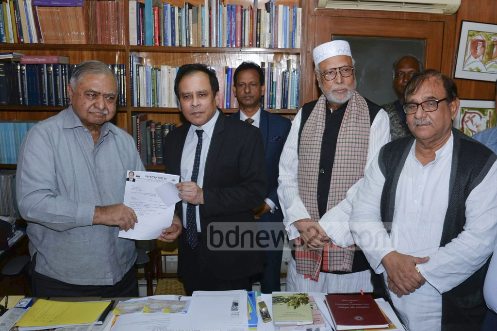 Former finance minister and slain Awami League leader Shah AMS Kibria's son Reza Kibria submitting his nomination form for the parliamentary elections to Gono Forum chief Dr Kamal Hossain at his chamber on Sunday.