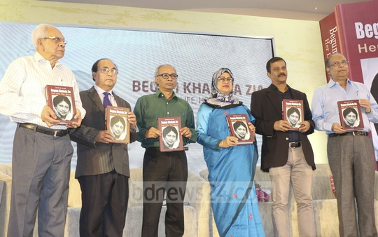 Guests holding the book, 'Begum Khaleda Zia: Her Life, Her Story', authored by Mahfuz Ullah, at its launch at a Dhaka hotel on Sunday.