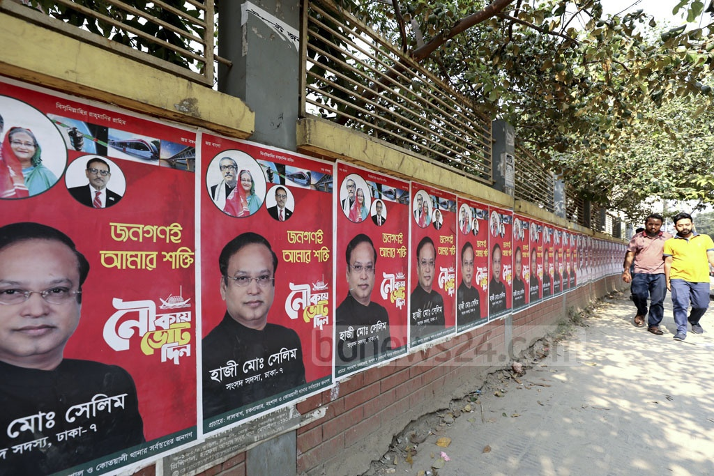 Though the Election Commission has ordered all campaign posters, banners and festoons to be removed by Sunday, various portions of the capital are still plastered with the political advertisements, as seen in Dhaka's Katabon area.