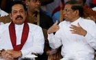 Sri Lanka's newly appointed Prime Minister Mahinda Rajapaksa and President Maithripala Sirisena talk during a rally near the parliament in Colombo, Sri Lanka Nov 5, 2018. REUTERS
