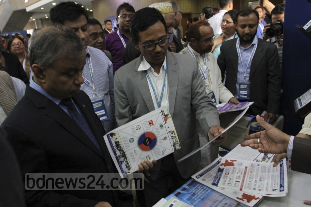 Abul Kalam Azad, chief coordinator of SDG affairs in the Prime Minister's Office, visiting stalls after inaugurating Bangladesh Digital Financial Inclusion Conference 2018 in the capital's Bangabandhu International Conference Centre on Tuesday. Photo: Asif Mahmud Ove