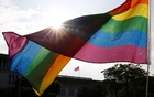 A rainbow flag is seen in front of Taiwan's flag during a rally to support the upcoming same-sex marriage referendum, in Taipei, Taiwan Nov 18, 2018. REUTERS