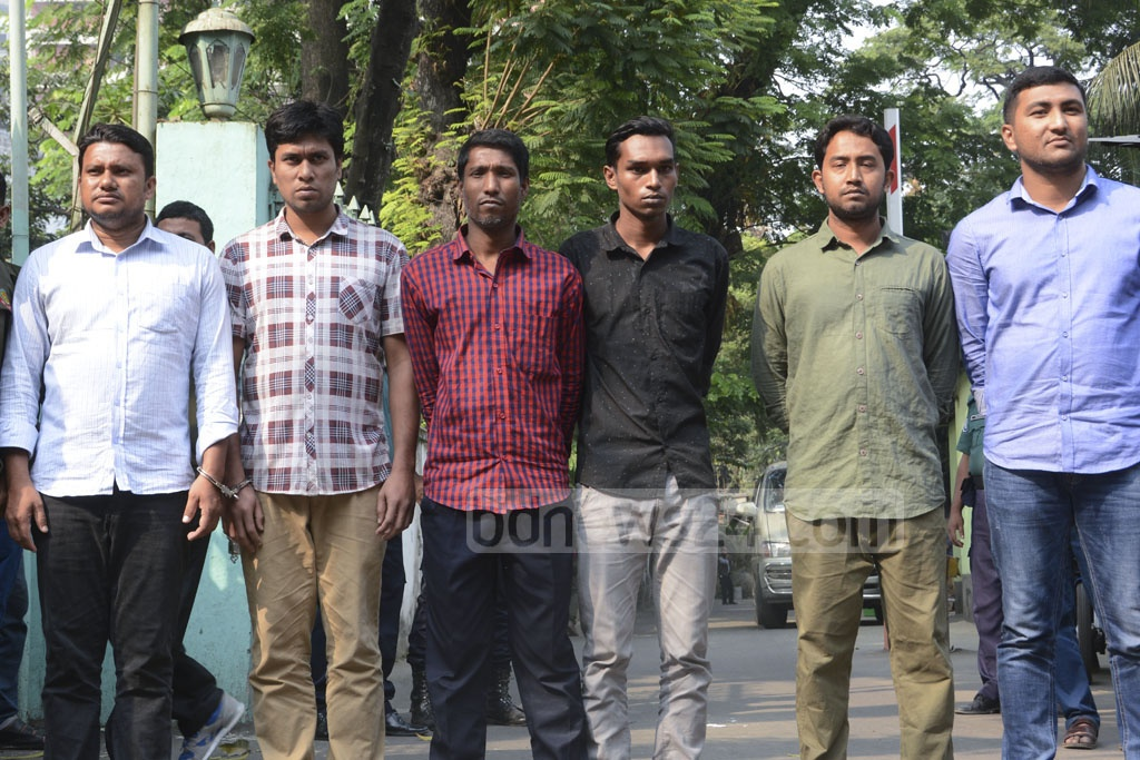 Police produced before the media on Tuesday the six people arrested on charges of vandalising and torching police cars during clashes with BNP supporters at Naya Paltan on Nov 14.