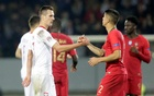 Poland's Arkadiusz Milik shakes hands with Portugal's Joao Cancelo after the match. UEFA Nations League - League A - Group 3 - Portugal v Poland - Estadio D. Afonso Henriques, Guimaraes, Portugal - November 20, 2018. Reuters