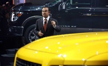 Carlos Ghosn, chairman and chief executive of Renault and Nissan, reveals the line of Nissan Titan pickup trucks at the North American International Auto Show in Detroit, Jan. 12, 2015. The New York Times
