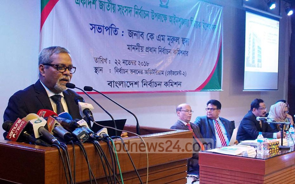 KM Nurul Huda, who heads the Election Commission, speaking at a special meeting with law-enforcing agencies at his office in Dhaka on Thursday ahead of the parliamentary elections .