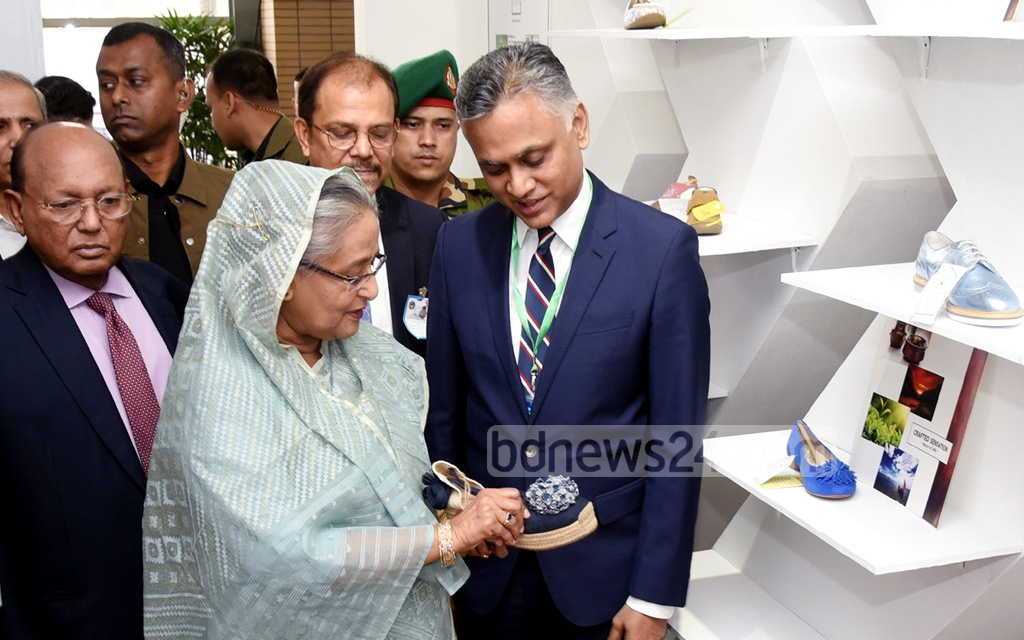 Prime Minister Sheikh Hasina visiting a stall after inaugurating 'Bangladesh Leather Footwear and Leather Goods International Sourcing Show -2018' in Bangabandhu International Conference Centre in Dhaka on Thursday.