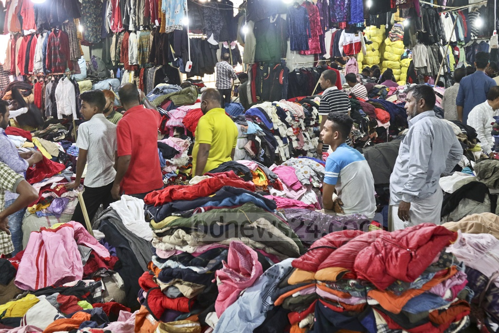 Sale of worn winter clothes has peaked as the cold starts to wrap Bangladesh. This photo was taken from a makeshift market inside an under-construction government building at Dhaka's Sadarghat on Thursday. Photo: Abdullah Al Momin