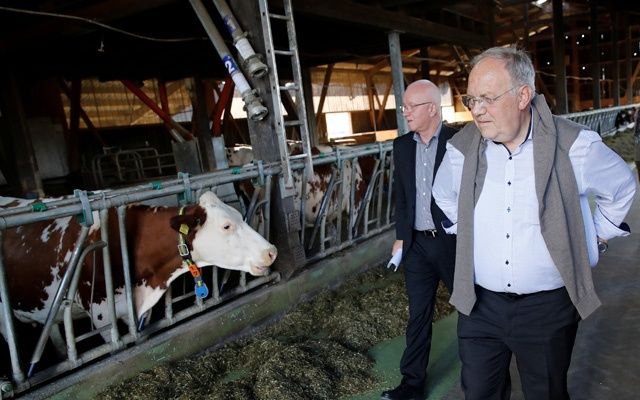 Swiss Economics Minister Johann Schneider-Ammann visits the farm of Stefan Gilgen-Studer in Oberwangen, Switzerland, November 12, 2018. Reuters