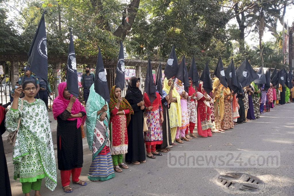 Green Bangla Garment Workers Federation forms a human chain in front of the National Press Club in Dhaka on Friday in memory of the workers killed in the horrific fires at the Tazreen Fashions factory six years ago.