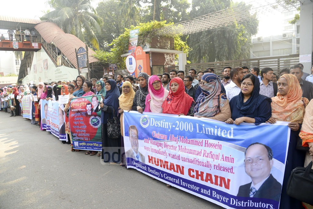A demonstration in front of the National Press Club on Saturday calls for the release of Destiny Group director and manager.