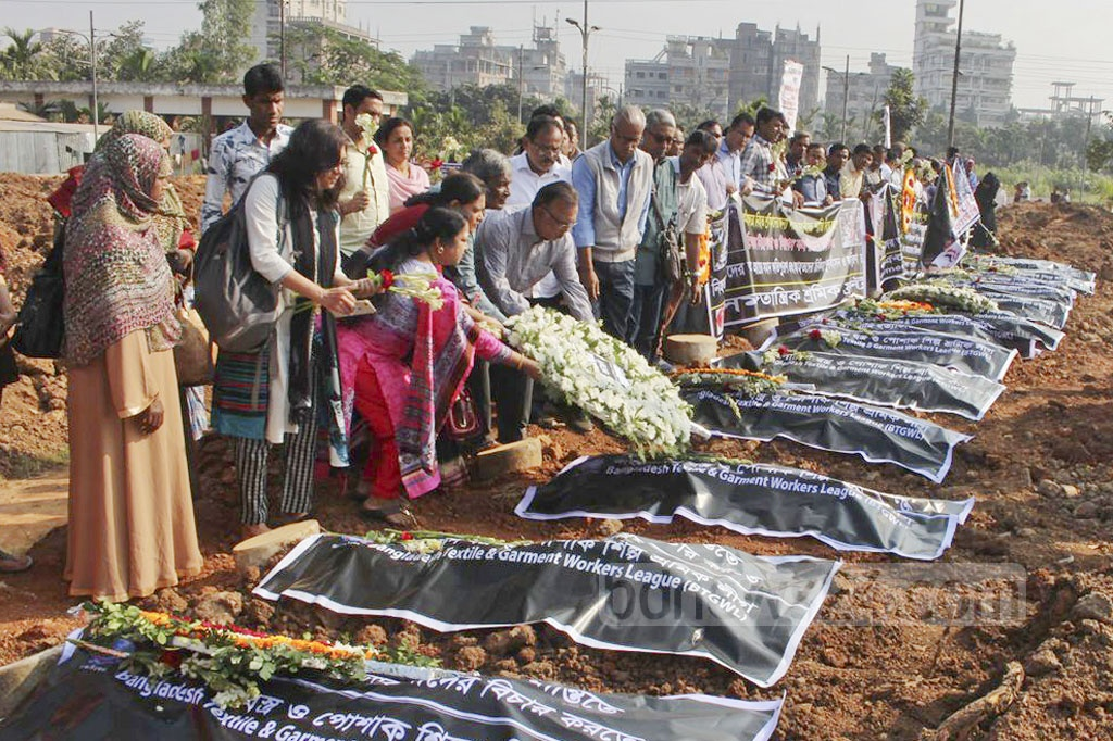Relatives and labour organisations pay tribute to Tazreen Fashions fire victims by placing wreaths at the Zurain graveyard in Dhaka on Saturday, marking the sixth anniversary of the tragedy.