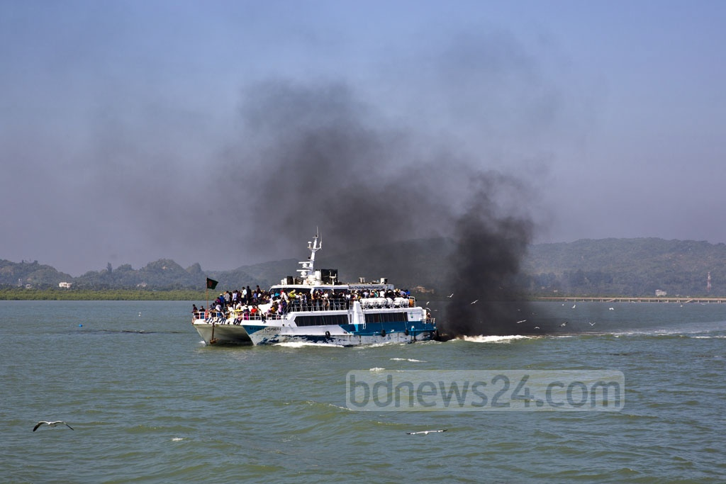 A catamaran vessel belonging to the Bay Cruiser company takes tourists from Teknaf to St Martin's Island, belching black smoke on the way. Photo: Mostafigur Rahman