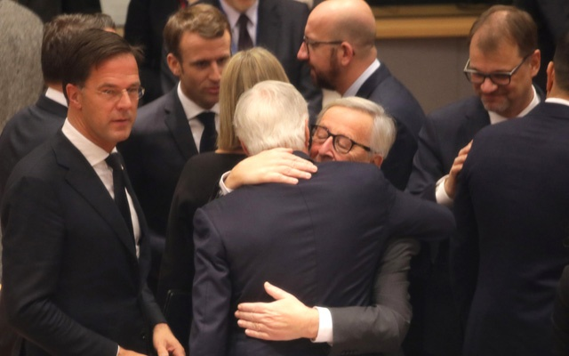 European Commission President Jean-Claude Juncker, center right, embraces European Union chief Brexit negotiator Michel Barnier during a round table meeting at an EU summit in Brussels, Belgium Nov 25, 2018. Olivier Matthys/Pool via REUTERS