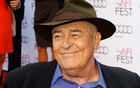 FILE PHOTO: Italian director Bernardo Bertolucci is interviewed as he arrives for a gala screening of his film