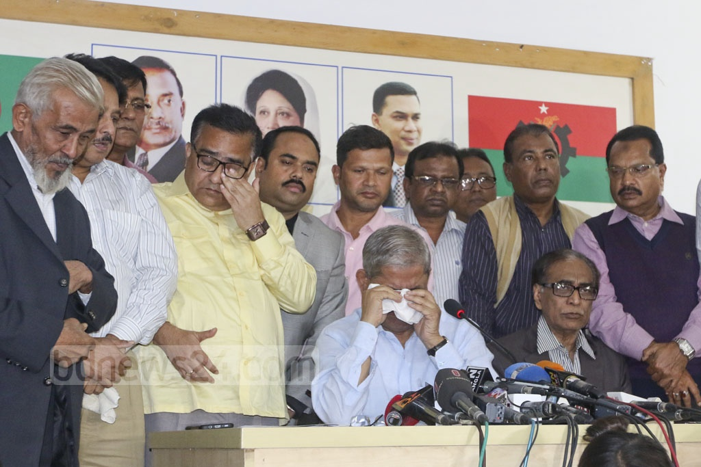 BNP Secretary General Mirza Fakhrul Islam Alamgir breaks down in tears after recalling party chief Khaleda Zia's imprisonment in prison during the distribution of confirmation letters for the 11th parliamentary elections. Photo: Abdullah Al Momin