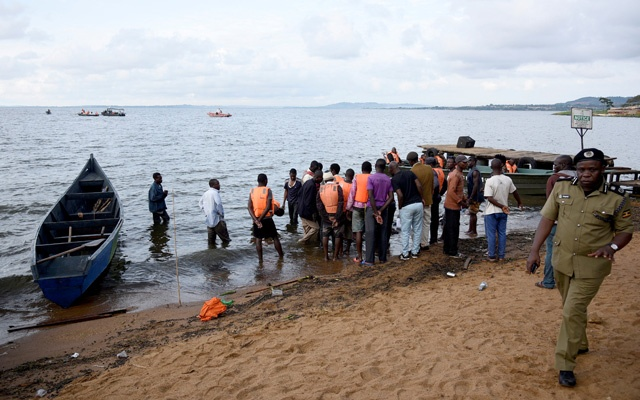 Rescue and recovery missions gather at the shores of Lake Victoria during the search for the bodies of dead passengers after a cruise boat capsized off Mukono district Uganda Nov 25 2018. REUTERS