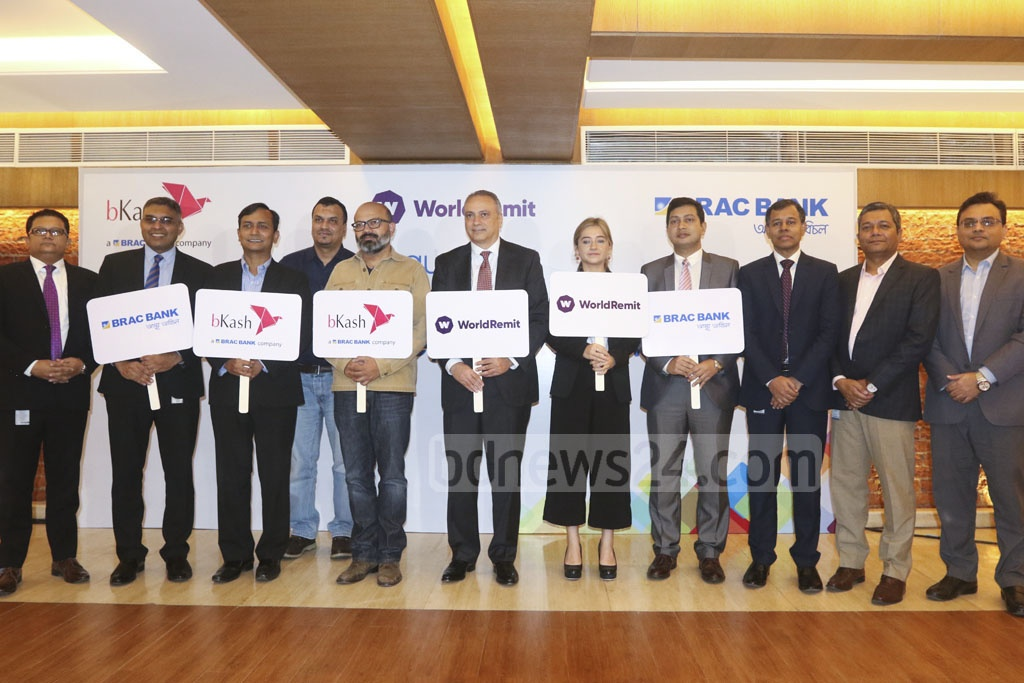 Officials posing for a photo after a press conference marking the partnership between bKash, BRAC Bank and London-based WorldRemit in Dhaka on Tuesday. Photo: Abdullah Al Momin