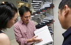 Scientist He Jiankui shows 'The Human Genome', a book he edited, at his company Direct Genomics in Shenzhen, Guangdong province, China August 4, 2016. Reuters