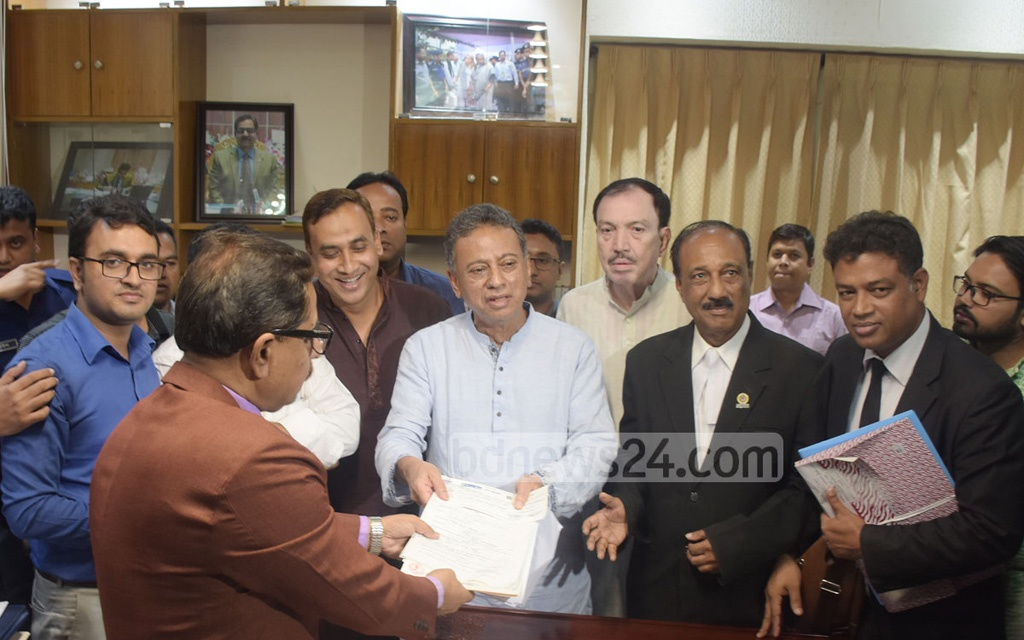 BNP candidate for Chattogram-11 Amir Khasru Mahmud Chowdhury submitting his nomination paper to the returning officer on Wednesday.