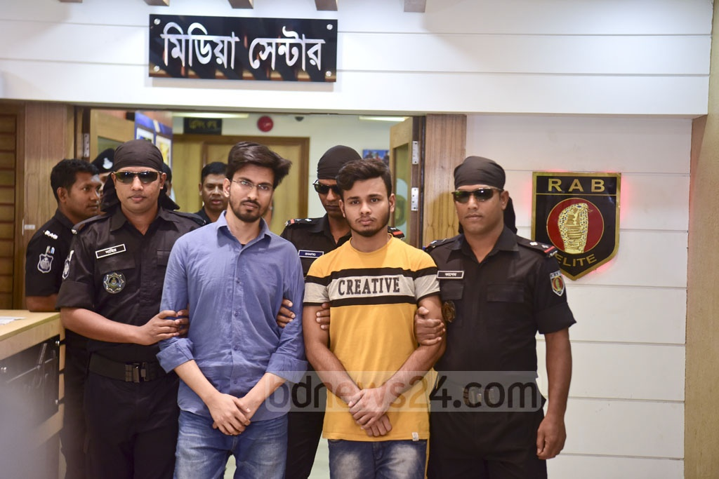 Two persons arrested on charges of spreading fake news on Facebook are paraded before the media in Dhaka on Thursday.