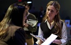 A woman speaks to a potential employer at the