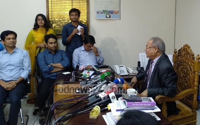 Election Commissioner Md Rafiqul Islam speaking to reporters.