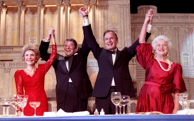FILE PHOTO: US President Ronald Reagan (2nd L) and Vice President GeorgeBush(2nd R), accompanied by wives Nancy (L) and Barbara, join hands after the President endorsesBush's run for the Presidency during the President's Dinner in Washington in this May 11, 1988 handout photo obtained by Reuters Nov 30, 2012. GeorgeBushPresidential Library and Museum/Handout via REUTERS/File Photo