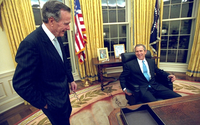 FILE PHOTO: US President George W Bushsits at his desk in the Oval Office for the first time on Inauguration Day as his father, former President George HWBush, looks on Jan 20, 2001. Eric Draper/Courtesy of White House Photo/Handout via REUTERSokBush-7 FILE PHOTO: US President George HW Bush(L) and Soviet President Mikhail Gorbachev shake hands in front of US\ and Soviet flags at the end of a news conference in Moscow July 31, 1991. REUTERS/Rick Wilking/File Photo