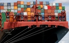 FILE PHOTO: Shipping containers are stacked on a cargo ship in the dock at the ABP port in Southampton, Britain August 16, 2017. Reuters