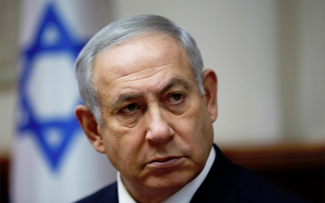 Israeli Prime Minister Benjamin Netanyahu attends the weekly cabinet meeting at his Jerusalem office Dec 2, 2018. Gali Tibbon/Pool via REUTERS