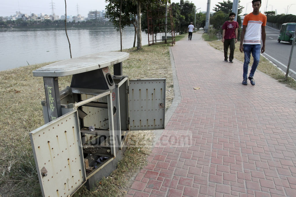 The authorities set up at Hatirjheel in Dhaka 320 dustbins with modern technology imported from China two and a half years ago. Many of these are out of service now due to lack of maintenance while the containers inside many of these have been stolen. This photo was taken on Sunday. Photo: Asif Mahmud Ove