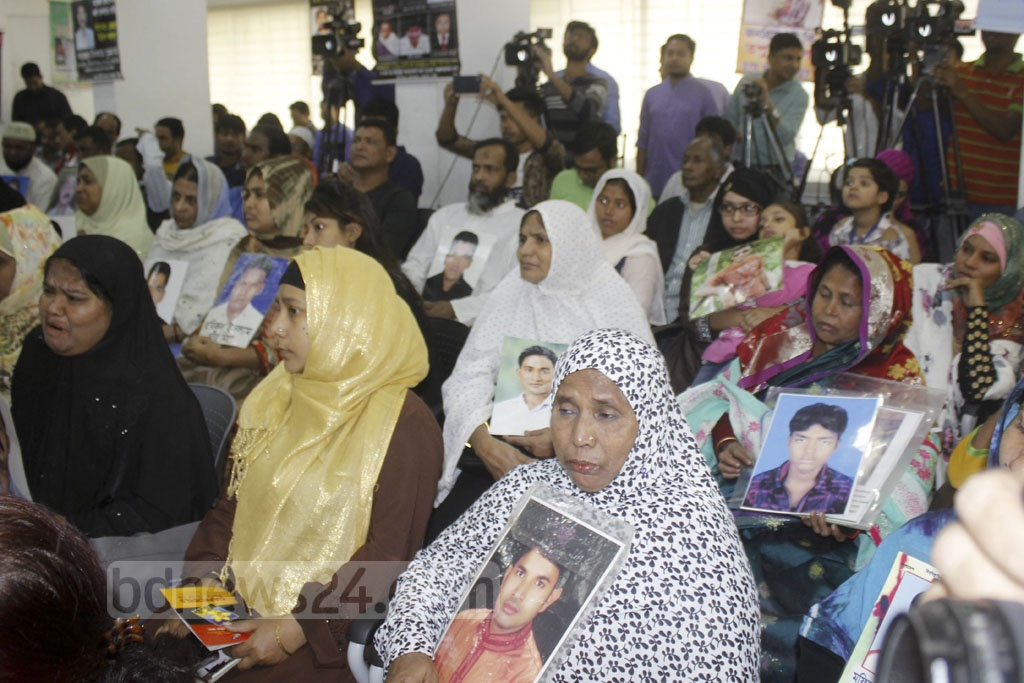 Relatives holding photos of some of the alleged victims of enforced disappearance in past few years during a discussion on the issue at the National Press Club in Dhaka on Tuesday.