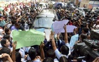 Students surround Education Minister Nurul Islam Nahid's car to protest Aritry Adhikary's death after his arrival at Viqarunnisa Noon School and College in Dhaka on Tuesday.
