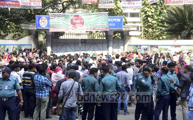 Students carry placards in front of Viqarunnisa Noon School and College to protest Aritry Adhikary's death on Tuesday.