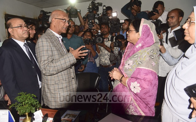 Education Minister Nurul Islam Nahid speaks to the principal of Viqarunnisa Noon School and College in Dhaka on Tuesday after the suicide of Aritry Adhikary, a student.
