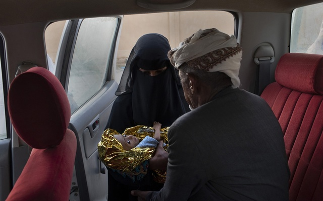 Ibrahim Ali Mohammed Junaid, 60, and his wife Zahra Ali Ahmed, 25, taking their malnourished son, Ahmed, 5 months old, to a clinic in Aslam, Yemen, Oct 19, 2018. The New York Times