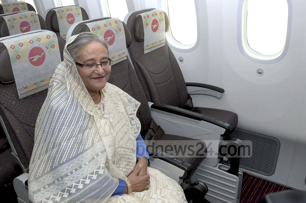 Prime Minister Sheikh Hasina takes a seat in the economy class as she inspects 'Hangsabalaka', the second Boeing 787-8 Dreamliner recently added to the fleet of Biman Bangladesh Airlines, at Shahjalal International Airport in Dhaka on Wednesday. Photo: ABM Aktaruzzaman / PID