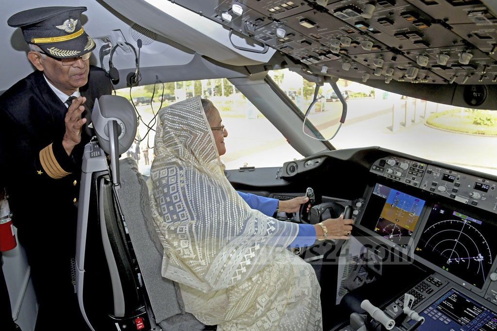 Prime Minister Sheikh Hasina takes the captain's seat as she inspects the cockpit of 'Hangsabalaka', the second Boeing 787-8 Dreamliner recently added to the fleet of Biman Bangladesh Airlines, at Shahjalal International Airport in Dhaka on Wednesday. Photo: ABM Aktaruzzaman / PID