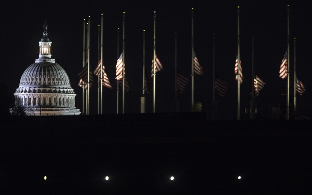 The flags surrounding the Washington Monument are at half-staff for the late President George H.W. Bush on Capitol Hill in Washington, Dec 4, 2018. The New York Times
