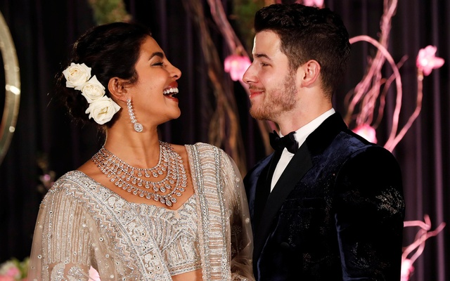Bollywood actress Priyanka Chopra and her husband singer Nick Jonas pose during a photo opportunity at their wedding reception in New Delhi, India Dec 4, 2018. REUTERS