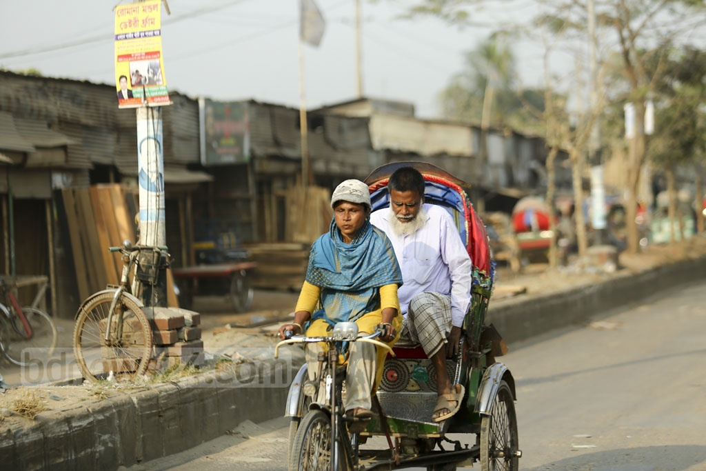 Aysha Akhtar earns a living operating a rickshaw in Dhaka's Mirpur-Vasantek area. She makes about Tk 250 a day. Her family lives on the amount left over after the instalment payments on the vehicle. Photo: Mahmud Zaman Ovi