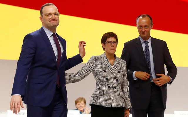 Annegret Kramp-Karrenbauer waves next to German Chancellor Angela Merkel after being elected as the party leader during the Christian Democratic Union (CDU) party congress in Hamburg, Germany, December 7, 2018. Reuters