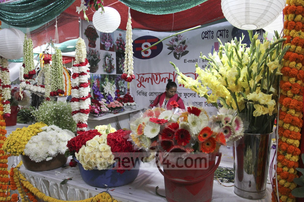 Various flowers decorate a stall at the International Flower Exhibition and Conference 2018 at the Bangabandhu International Conference Centre on Friday. Photo: Asif Mahmud Ove