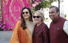 Former US Secretary of State Hillary Clinton poses with Mukesh Ambani, Chairman of Reliance Industries, and his wife Nita Ambani after her arrival in Udaipur to attend pre-wedding celebrations of their daughter Isha Ambani in the desert state of Rajasthan, India, December 8, 2018. Reliance Industries/Handout via REUTERS