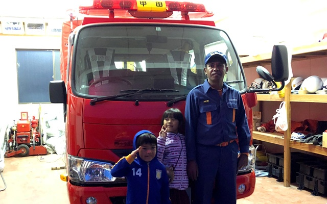 East Timorese Leonel Maia, 33, poses for a photograph with his children at a fire station where he volunteers as a firefighter in Akitakata, Hiroshima prefecture, western Japan November 26, 2018. Reuters