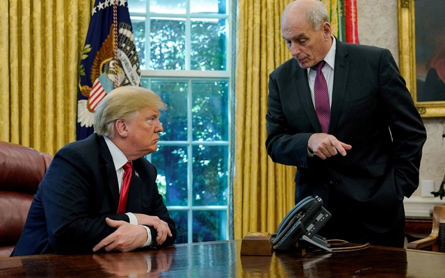 FILE PHOTO: US President Donald Trump speaks to White House Chief of Staff John Kelly after an event with reporters in the Oval Office at the White House in Washington, US Oct 10, 2018. REUTERS/Jonathan Ernst/File Photo