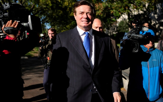 FILE PHOTO: Former Trump 2016 campaign chairman Paul Manafort leaves US Federal Court after being arraigned on twelve federal charges in the investigation into alleged Russian meddling in the 2016 US presidential election in Washington, US Oct 30, 2017. REUTERS/James Lawler Duggan/File Photo