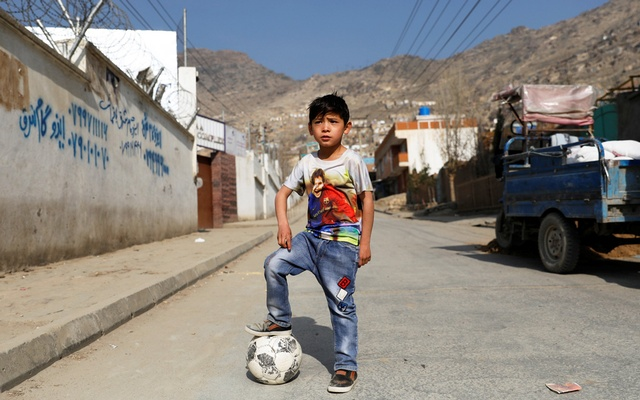 Murtaza Ahmadi, 7, an Afghan Lionel Messi fan, plays football outside his house in Kabul, Afghanistan December 8, 2018. Reuters