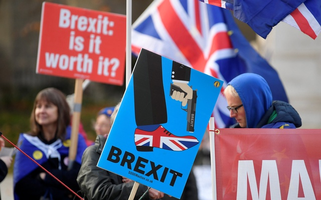 Anti-Brexit protesters hold posters and flags in Whitehall, in central London, Britain Dec 6, 2018. REUTERS/ Toby Melville